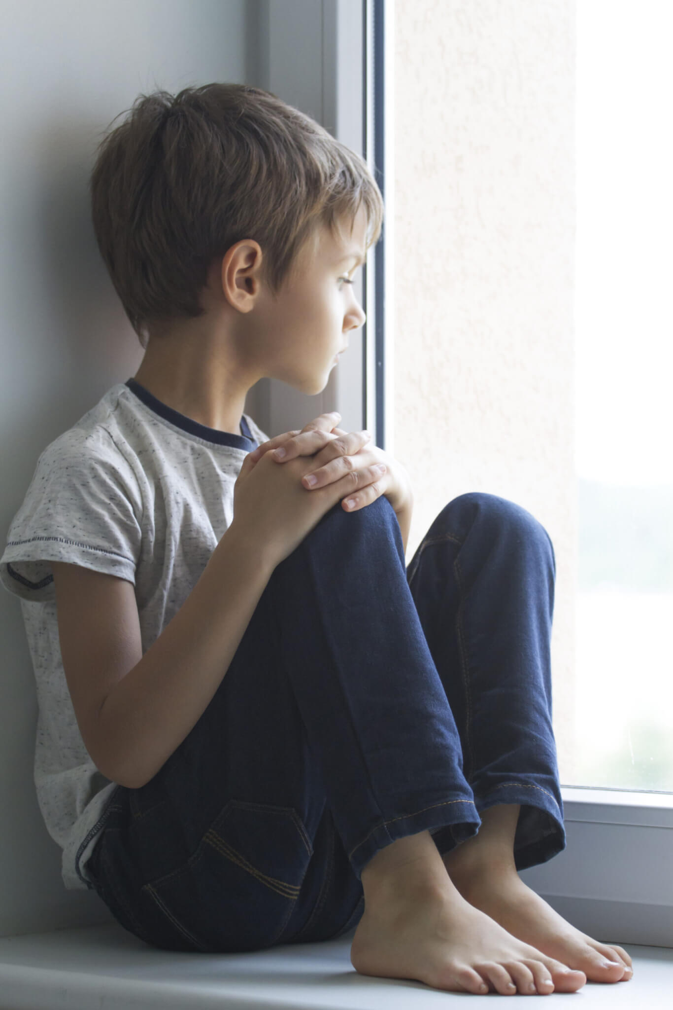 melancholy child looking out window